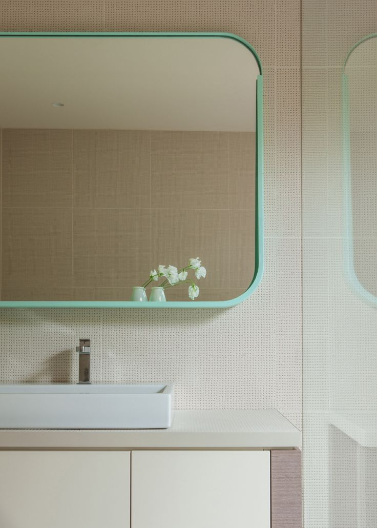 A skinny shot of aqua feels oh-so deft.  Hawthorn East House, designed by Fiona Lynch