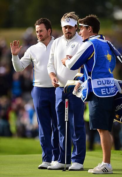 The European duo of Graeme McDowell and Victor Dubuisson blew by Americans Rickie Fowler and Jimmy Walker 5 and 4 in the afternoon.