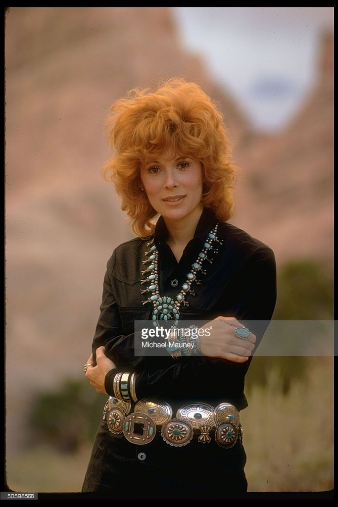Actress Jill St. John wearing plethora of turquoise jewelry, made by Navajo Indians, including squash blossom necklace, concha belt