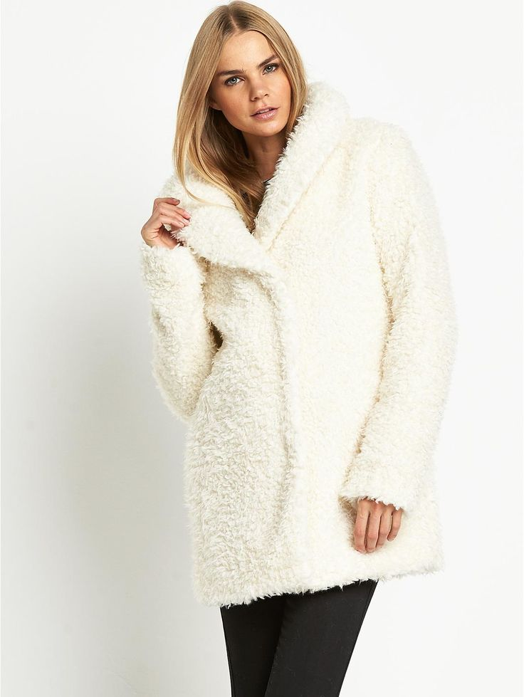 Love Label Teddy Bear Fluffy Coat Set a date for a snuggle session and look forward to a love in with this teddy bear fluffy coat by Love Label.The perfect cuddle-me-quick coat, this nubby winter white cover up is perfect for staying snug when the cold creeps in. This season is all about fun, furry textures in ice cream palettes and this fluffy coat ticks all of the boxes. Popper buttons block out any breeze and side pockets keep your mitts warm. The oversized collar and cute boxy silhouette…