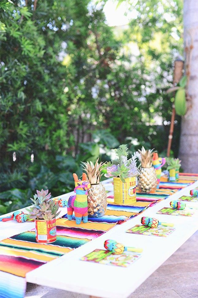 Use a Mexican blanket table runner and mini piñatas to give your table some oomph.