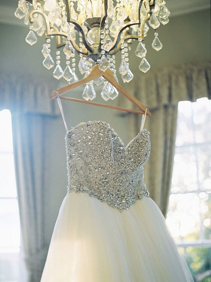 A glittering, strapless Maggie Sottero Gown  Photography by http://georginaharrisonphotography.co.uk