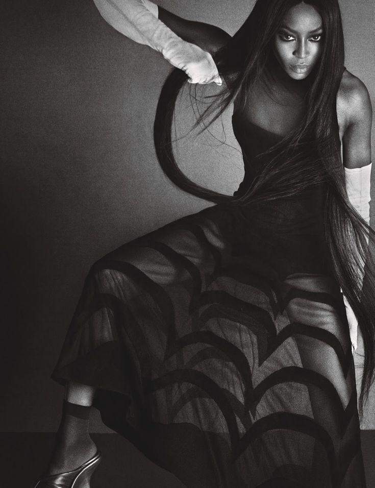 Serving a fierce look, Naomi Campbell wears Azzedine Alaïa dress, Gaspar Gloves and Balenciaga shoes
