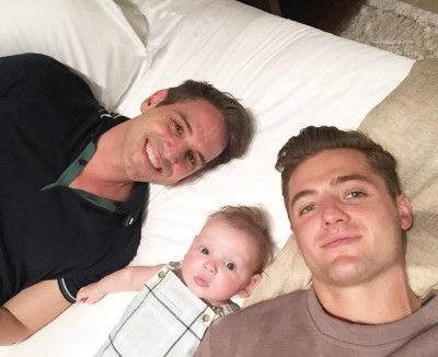 LA Galaxy star Robbie Rogers with partner Greg Berlanti whose son Caleb Gene was born earlier this year.