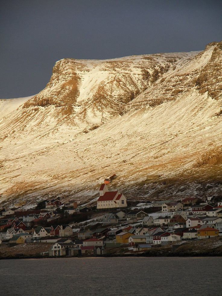 """Tvøroyri, Suðuroy, Faroe Islands - Light and Shadow"" by Eileen Sanda on Flickr - View from the ferry Smyril, which has 2-3 daily departures from Torshavn, the capital.  Tvoroyri is one of the largest towns on the island, Suouroy.  There are 18 islands in the faroes, only one of them, Little Dimun, is uninhabited."