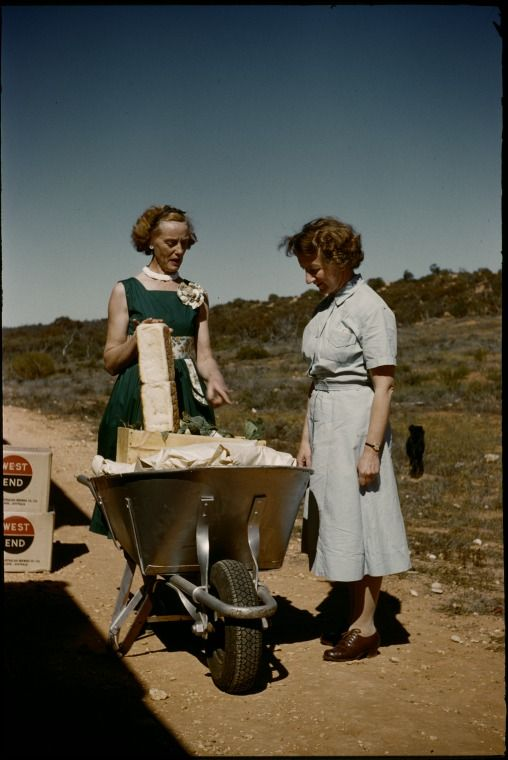 133332PD: Shopping with wheelbarrow at the Tea and Sugar train, Trans-Australian Railway, between 1958 and 1963.  http://encore.slwa.wa.gov.au/iii/encore/record/C__Rb3760399__S133332pd__Orightresult__U__X3?lang=eng&suite=def