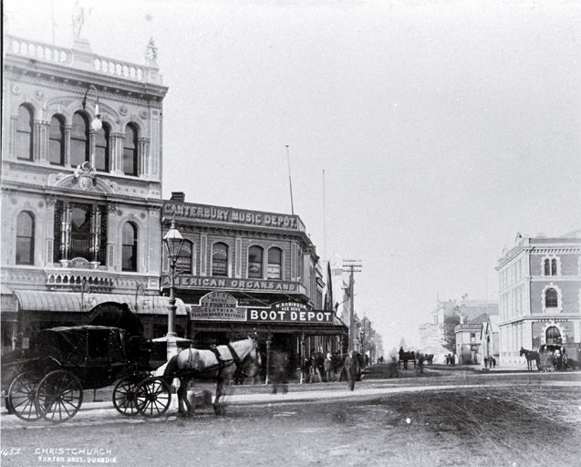 A hackney at the intersection of Cashel & High Streets : with Milner & Thompson's music store on the right & Inglis' building on the left.