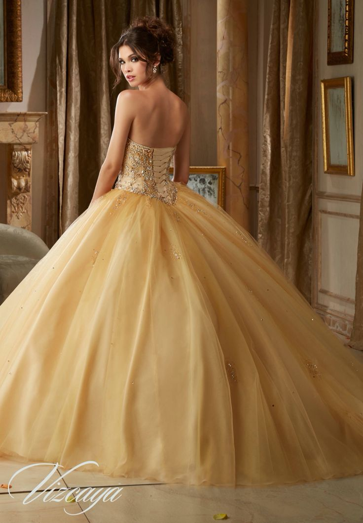 Morilee Vizcaya Quinceanera Dress 89109 GEMSTONE BEADING ON A TULLE BALL GOWN Matching Bolero Jacket. Available in Pink Panther, Gold, Scuba Blue, White (Color of this dress): Gold