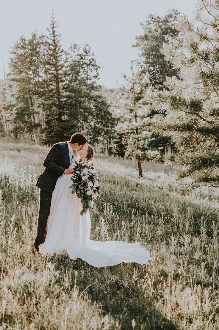 Incredible and dreamy sun kissed golden mountain elopement inspiration with a modest wedding dress. Utah mountain wedding surrounded by love and pine trees. || Photo by Simply Amor Photography