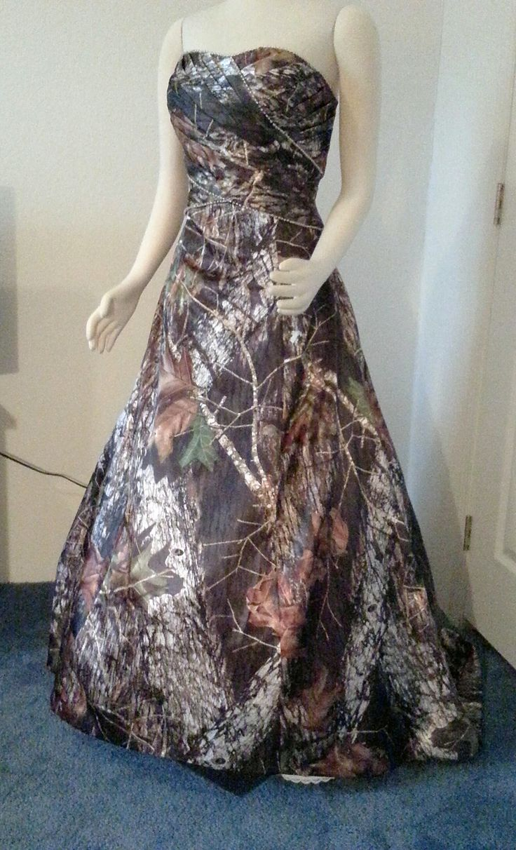 $400.  ATOC-0311C  called MICHELLE shown in Mossy Oak. Beaded and tucked bodice. Zip Up back.  IN STOCK in a size 16. This in stock one has a corset back and small sweep train at no extra charge. It was worn x1 in a fashion show for about one hr, but not dirty or damage.  Order here:  http://www.atouchofcamo.com/touchofcamo-details.cfm?ID=485