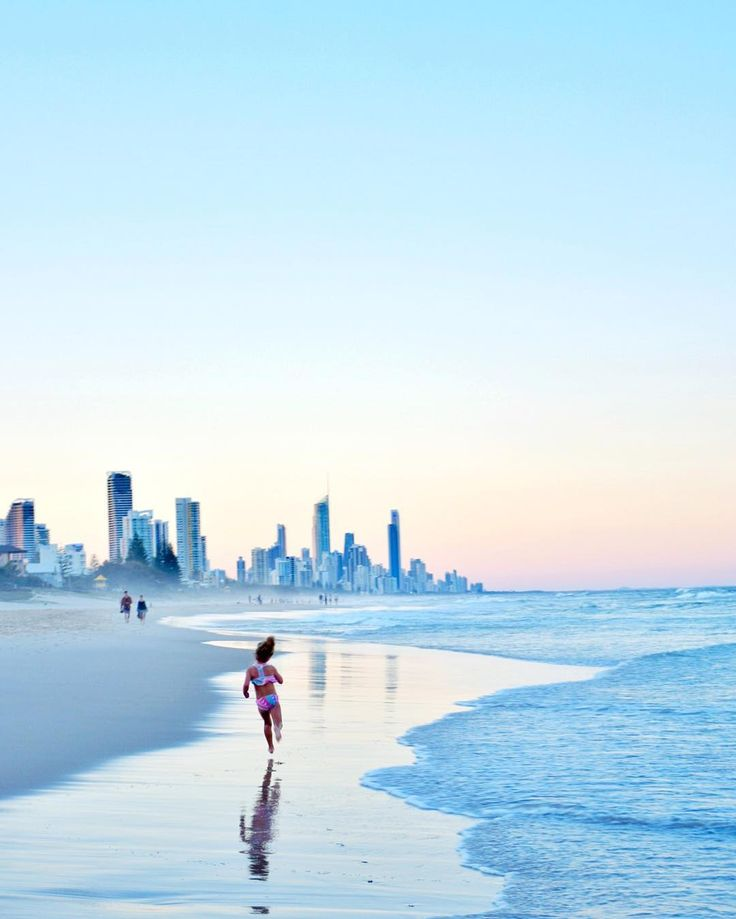 A view of Surfers Paradise as seen at sunset from beautiful Mermaid Beach by @alittleatlarge