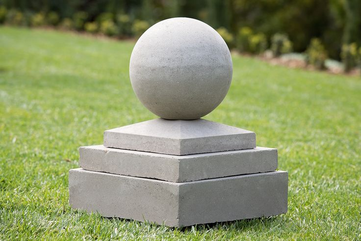 stone sphere perched on a plinth - a combination of tapered and square.