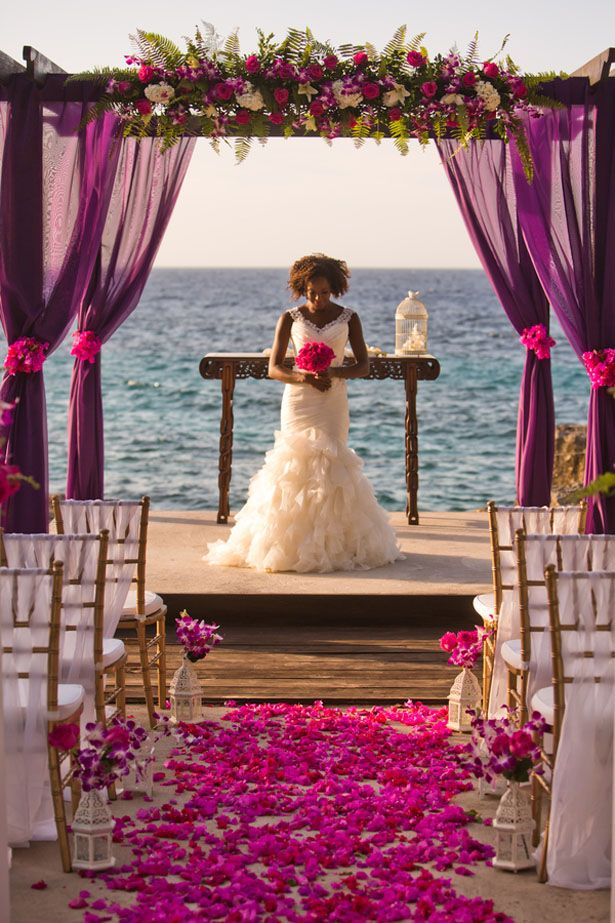 A Jamaica Destination Wedding Inspiration with tropical elegance vibes. The ceremony in shades of purple brings to life the Caribbean sea.