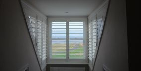 shutters on dorma window sides and front overlooking the sea in sandsend near whitby