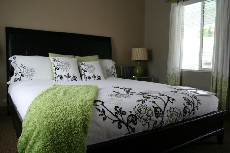 Relaxed shades of green and tan are the colors that await you in beautiful Deluxe Room #10.