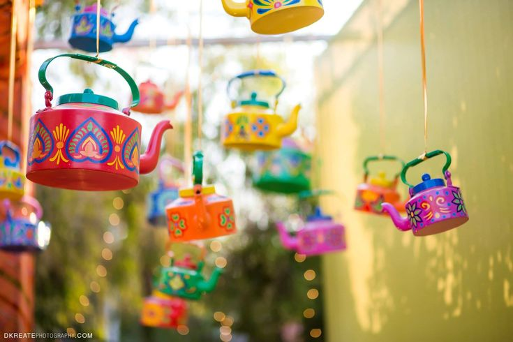 Colorful Photo booth ideas. Painted Tea Kettle. DIY decor for Mehndi party