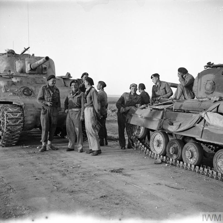 A Sherman Tank Crew Greets A Valentine Tank Crew At The Link Up Of The