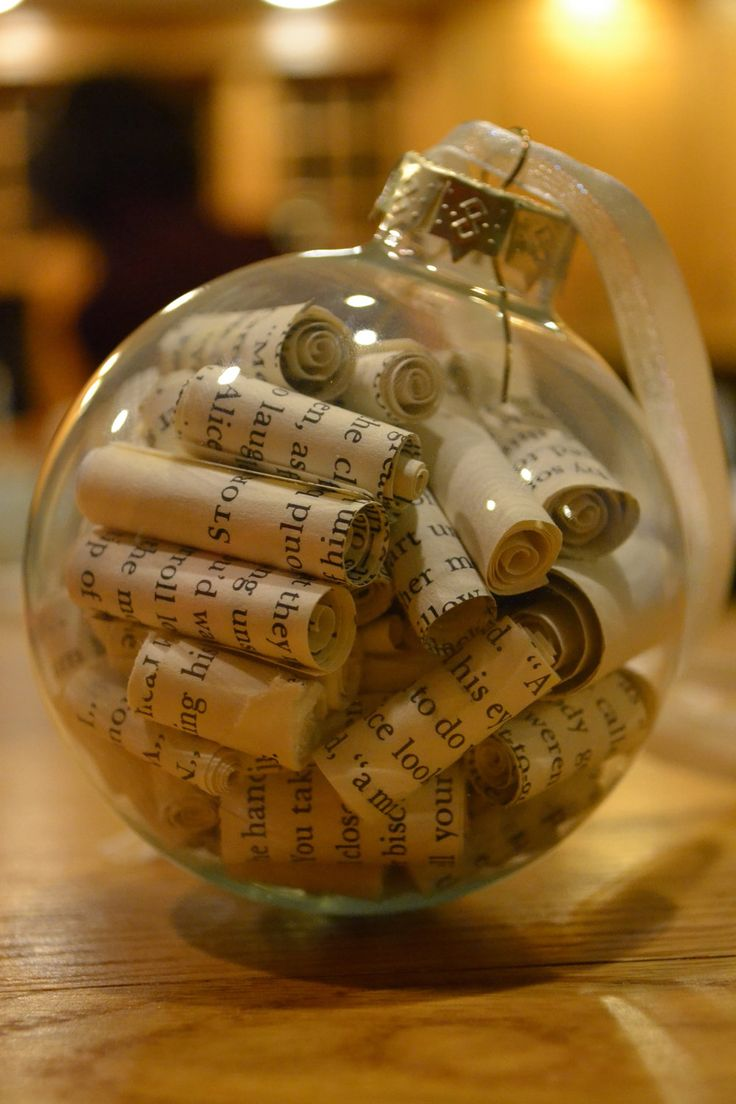 "If you're crafty, and looking for gift ideas, recycle your falling-apart books and whip up an ornament, or two.  (We think adding a bit of glitter or ""snow"" might be a nice touch.  But, then, we are not crafty.  Heh. Via Etsy.)"