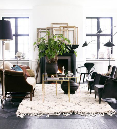 White black gold/gilt/brass, velvet, dark wood, beni ourain rug, green leaves. Mix of modern and traditional and ethnic