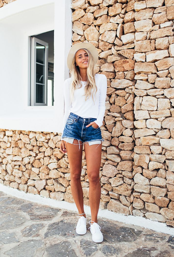 Browse the best denim short outfit inspiration and products at @Stylecaster | blogger @jannideler in all-white and cutoff blue jean shorts