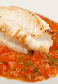 Monkfish with tomato, ginger and garlic - Shaun Hill. This is a simple seafood recipe to prepare that would be great with slices of garlic bread.