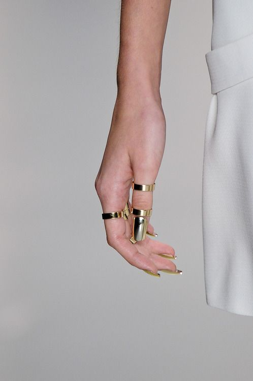 high end look. great gold rings and metallic nails
