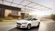 The 2014 Ford Fusion Titanium shown in White Platinum Tri-coat Metallic with available moonroof.