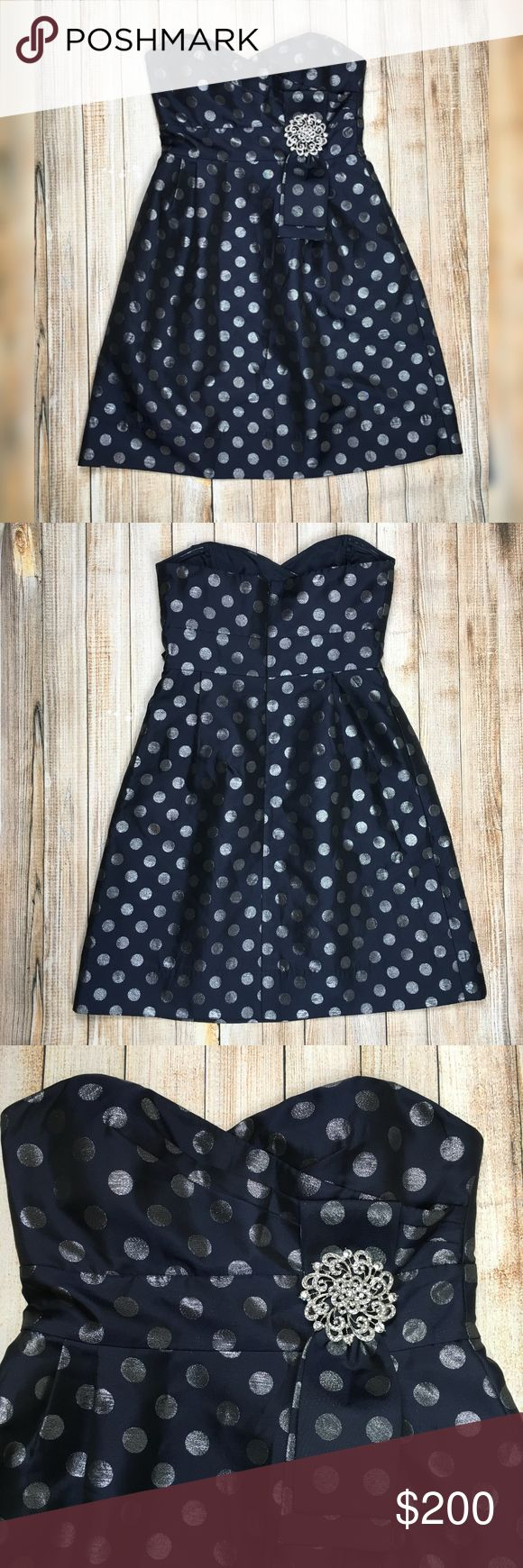 Eliza J polka dot party dress in navy and silver Eliza J polka dot fit and flare dress in navy and silver. Strapless sweetheart neckline with rhinestone pin embellishment, the silver polka dots shimmer just enough to grab your attention against the navy.   Like new condition, no flaws.   Approximate measurements provided in photos.   OFFERS ENCOURAGED!  Tags: military ball, homecoming, formal, fancy, pretty, girly, flirty, date night, wedding guest, bridesmaid, bow, navy blue, special…