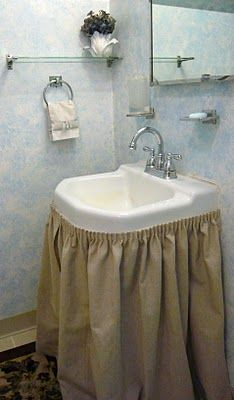No Sew Sink Skirt using shirring tape...I could use a couple of these in my bathroom.