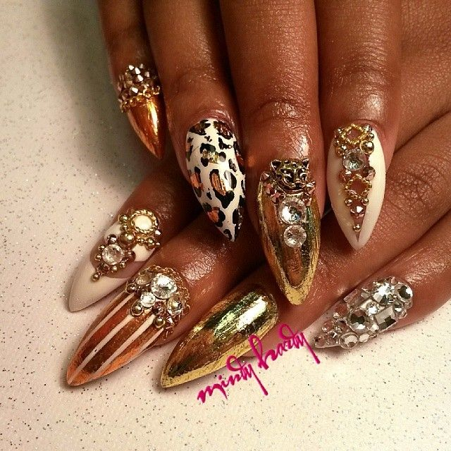 Gold foil and animal print nails by @Mindy Hardy on Instagram