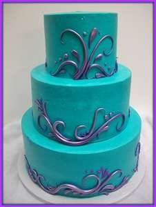 Make the teal parts white, and the top & bottom tiers have teal designs
