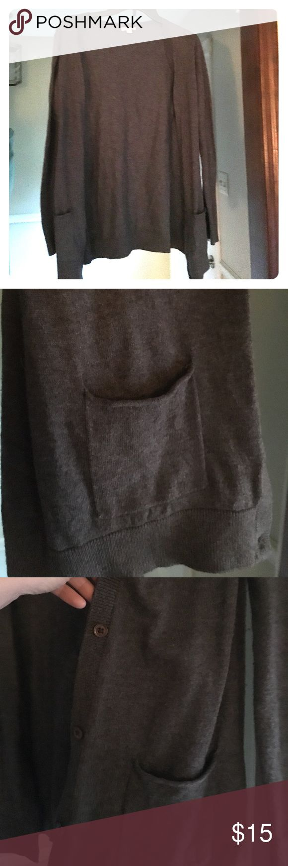 Cozy grey cardigan - GAP This dark gray cardigan has adorable pockets. Button closure. Warm and comfy. Excellent used condition. GAP Sweaters Cardigans