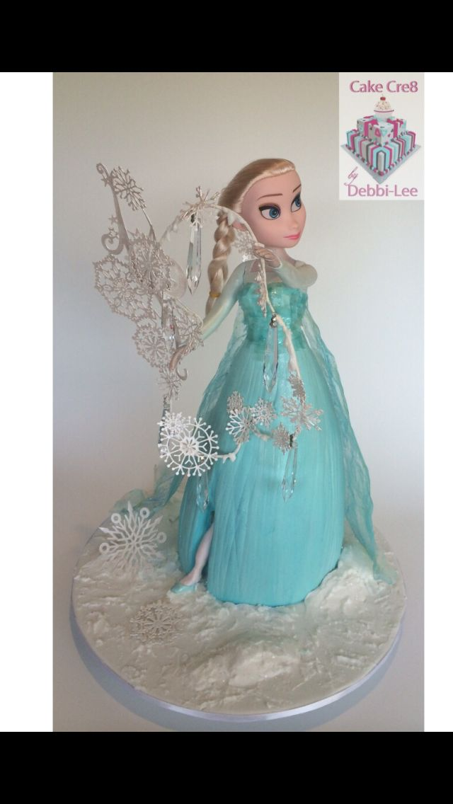 Elsa Doll Cake, made for my niece for her 6th birthday! Swarovski crystal Droplets, edible cake lace snow flakes, edible gelatin sequins and dress has gelatin shimmery drape. Airbrushed with ice blue pearl and glitter !