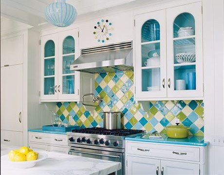 Love the white cabinets with arching glass fronts and the use of color for the backsplash and counter