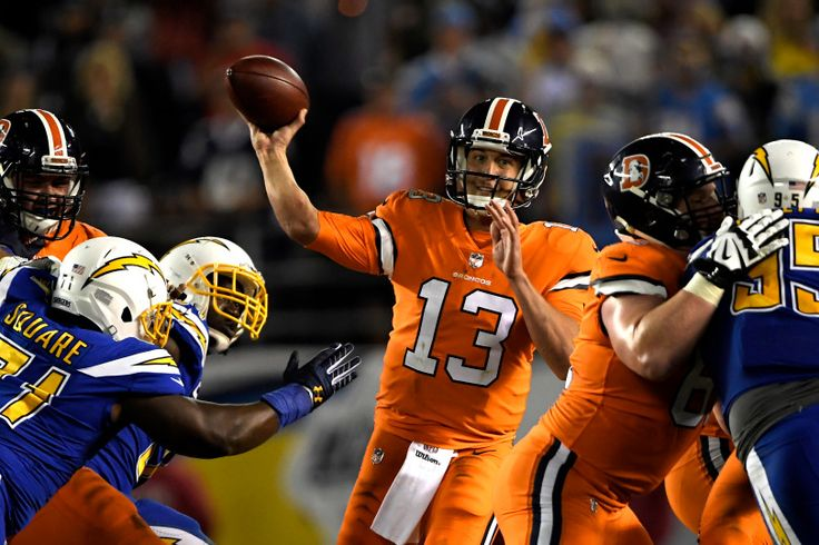 Broncos vs. Chargers:   October 13, 2016  -  21-13, Chargers   -      Denver Broncos quarterback Trevor Siemian #13 trying to complete a pass in the 4th quarter against the San Diego Chargers at Qualcomm Stadium, San Diego, CA October 13, 2016.