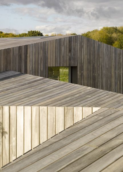 Year of Construction: 2012 An angled slatted wood facade intervenes into an existing vernacular.