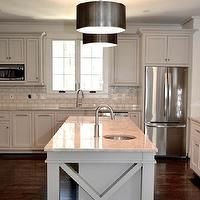 CS Interiors - kitchens - light gray kitchen cabinets: Benjamin Moore Revere Pewter with white marble look-alike: Mother of Pearl Quartzite, and pearl ash glazed subway tile backsplash. Center island is a white quartzite called Madreperola Quartzite