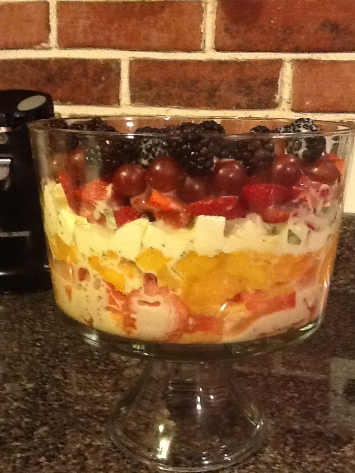 Fresh fruit layered with fresh mozzarella cheese, fresh sweet basil and lemon poppyseed dressing. I used from bottom .. Watermelon, peaches, mozzarella, strawberries, grapes, and blackberries.