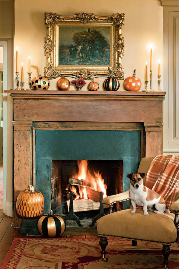 Gilded Pumpkin Display - Fall Fireplaces and Mantels - Southernliving. Gold and black pumpkins set the scene in this cozy spot.