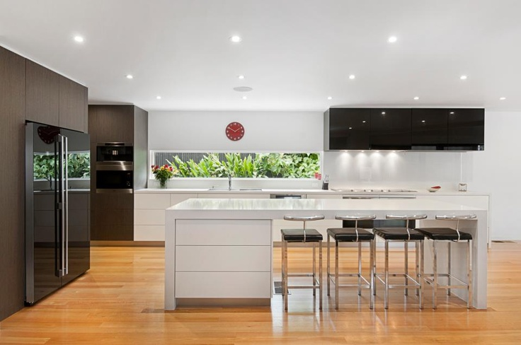 A kitchen from Caesarstone Australia - simple and elegant in black and white.