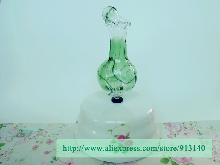 electric aroma diffuser, mixed-color, hand-crafted bottle, fixed operation time, safe tool