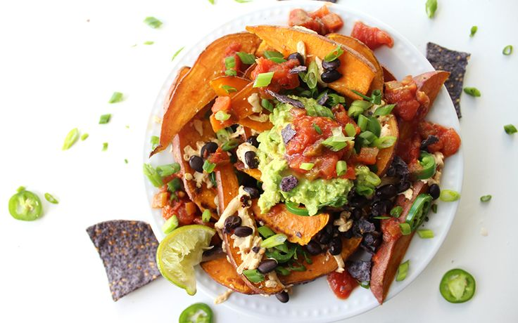 Crispy baked sweet potatoes are loaded with black beans and all kinds of goodies that'll knock all other loaded nachos out of the park.