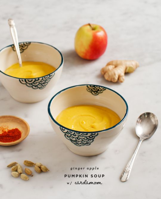 Ginger-Apple Pumpkin Soup -- just roast the veggies and apple, then toss into the blender with spices and coconut milk to make this creamy fall soup.