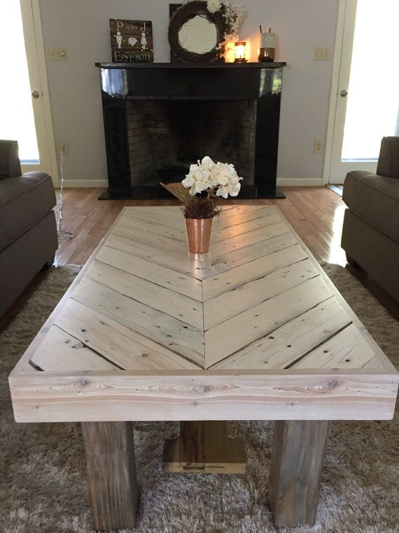 Custom built Rustic Chevron Coffee Table Floating stowaway shelf to keep items such as magazines, coasters, tv remote etc.. Stained and sprayed with a lacquer finish to give it a strong protective finish. Lacquer finish can be either dry rubbed (Matte) or clear gloss (shiny)