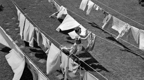 Clothesline: my mom did not have a dryer...all laundry was hung outside on the line to dry, even in winter. I can remember sheets being brought inside that were as stiff as a board until they thawed...DRY!  So fresh!