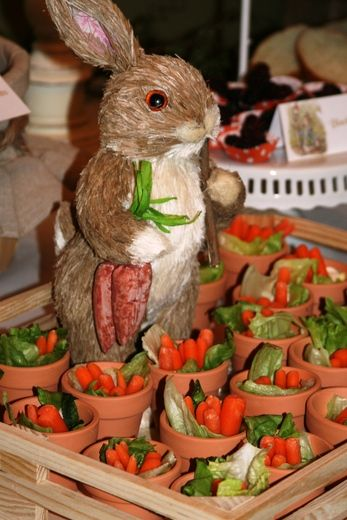 Vegetables in mini terra cotta pots. I already have bunnies I could use in center of tray-  this Would be a CUTE relish plate at Easter. Could even line a pot with foil & put veggie dip in it.