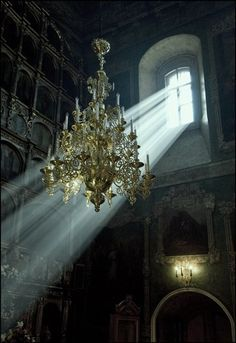A gorgeous chandelier still hangs in an abandoned mansion.