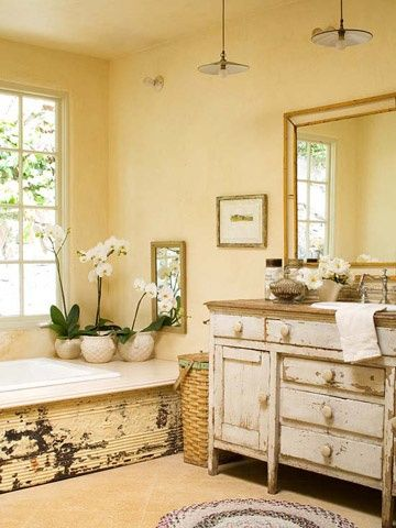Recycled Style Turn an old piece of furniture into a unique bathroom cabinet. The distressed finish of this buffet is right at home in this country bathroom. A standard bathtub gets a facelift with antique ceiling tile around the base. Vintage canisters add style and storage on the vanity..