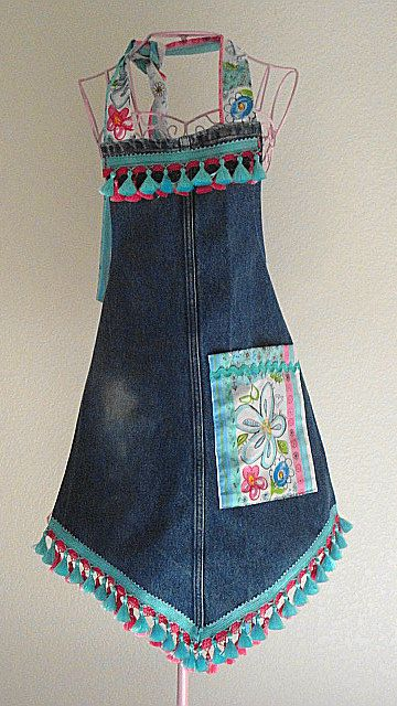 I like the cut of this, not so much the tassels and fabric. Recycled Denim Jeans Apron  Unique Shape  Sized by LizandLaurie, 15.00