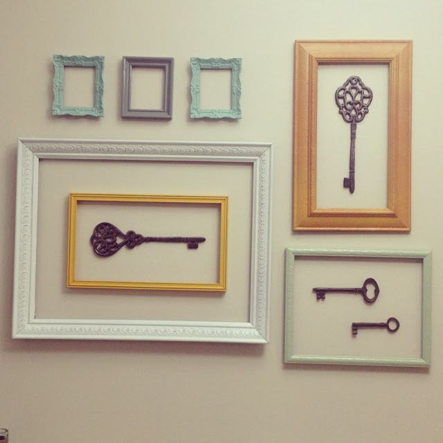 DIY frame wall. Old thrift store frames + spray paint!